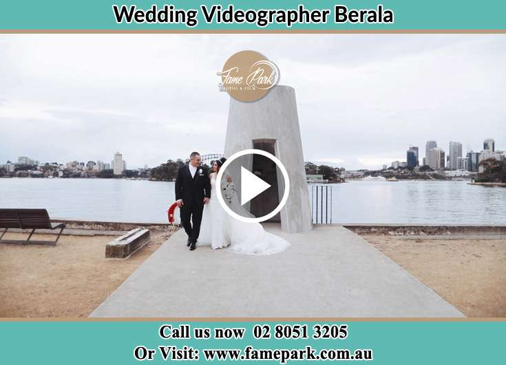 Bride and Groom walking at the shore Berala NSW 2141