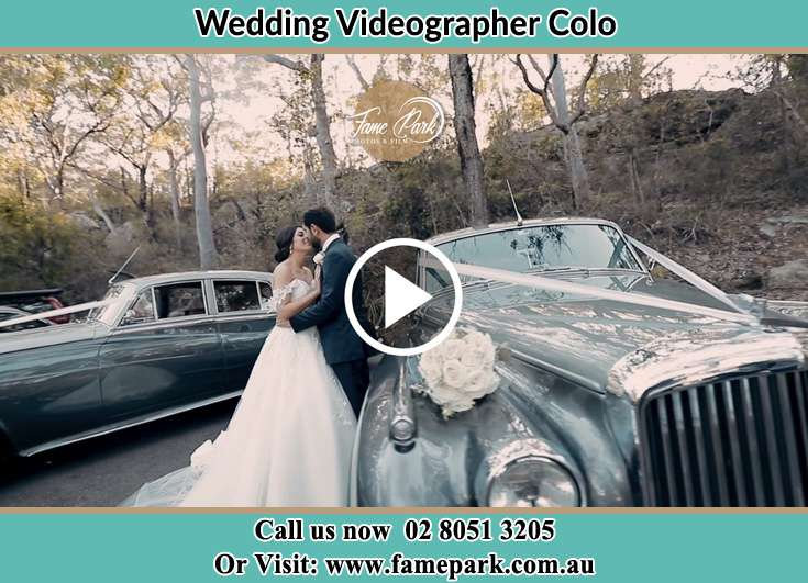 Bride and Groom kissed besides their bridal car Colo NSW 2756