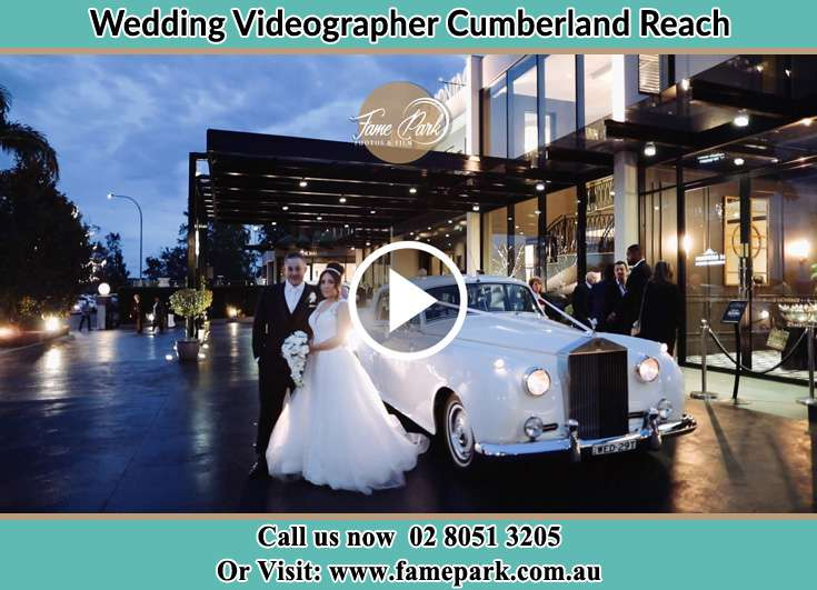 Bride and Groom standing near their bridal car Cumberland Reach NSW 2756