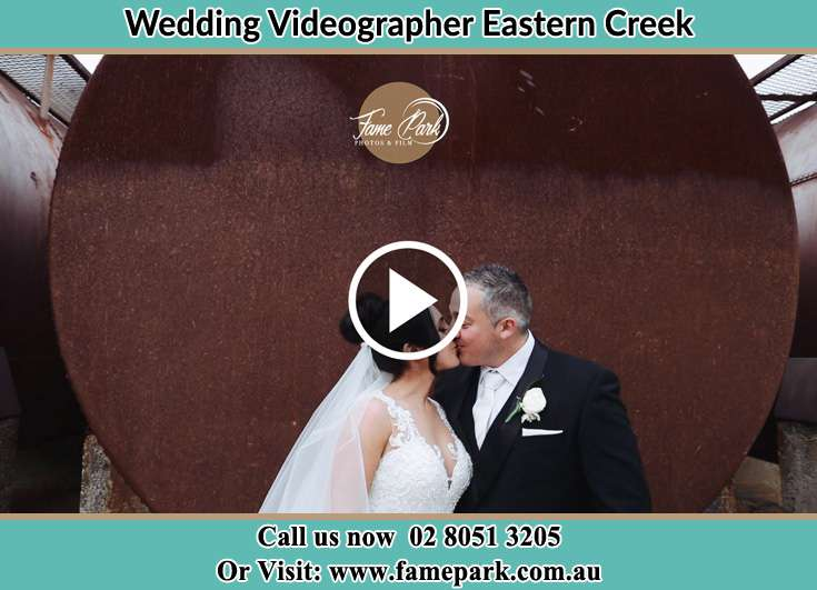 Bride and Groom kissed near the tank Eastern Creek NSW 2766