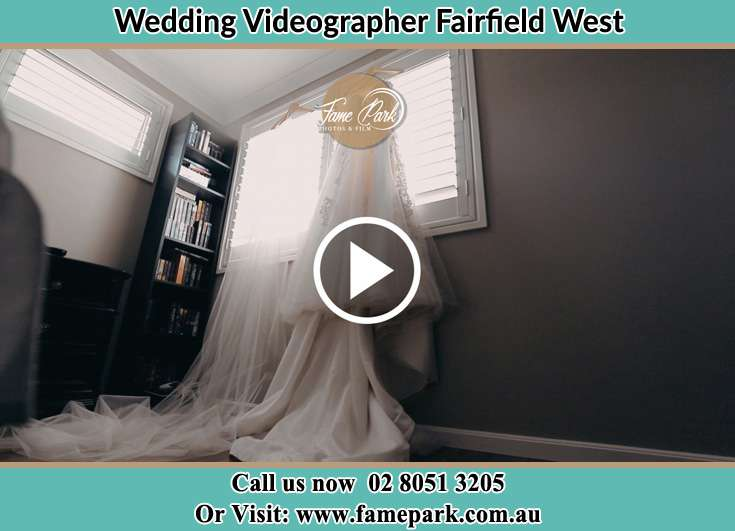 Bride wedding gown hang at the window Fairfield West NSW 2165