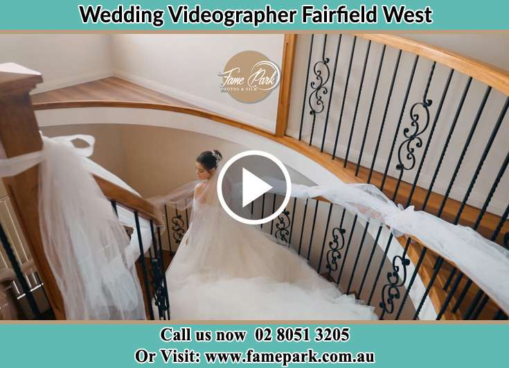 Bride walking down the staircase Fairfield West NSW 2165