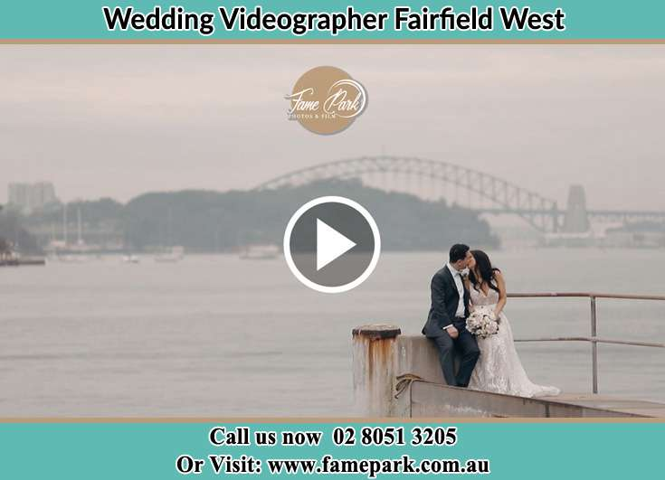 Bride and Groom kissed while sitting on near the shore Fairfield West NSW 2165