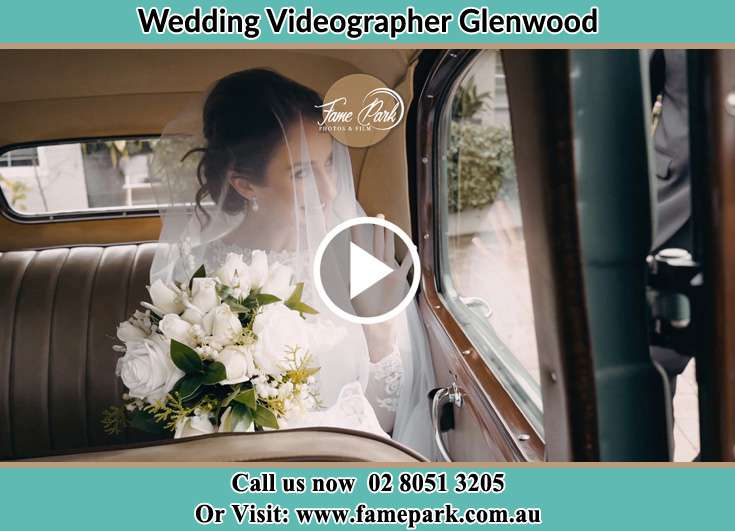 Bride holding a bouquet of flowers inside the bridal car Glenwood NSW 2768