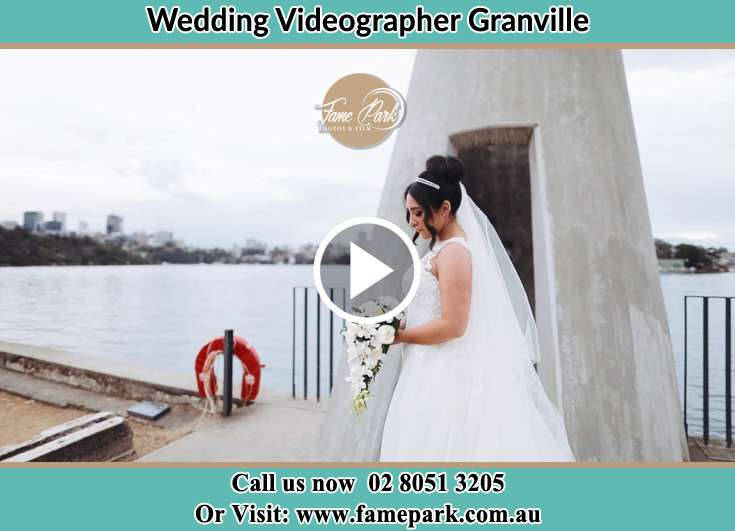 Bride holding a bouquet of flowers near the shore Granville NSW 2142