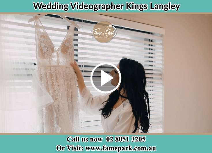Bride looking at her dress Kings Langley NSW 2147