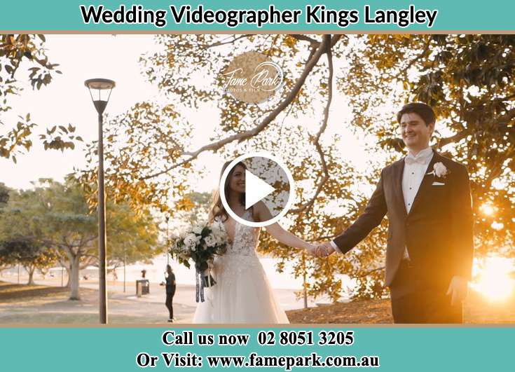 Bride and Groom walking in the park Kings Langley NSW 2147
