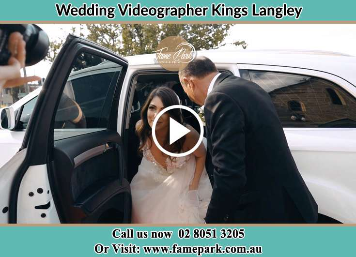 Bride getting out of the bridal car Kings Langley NSW 2147
