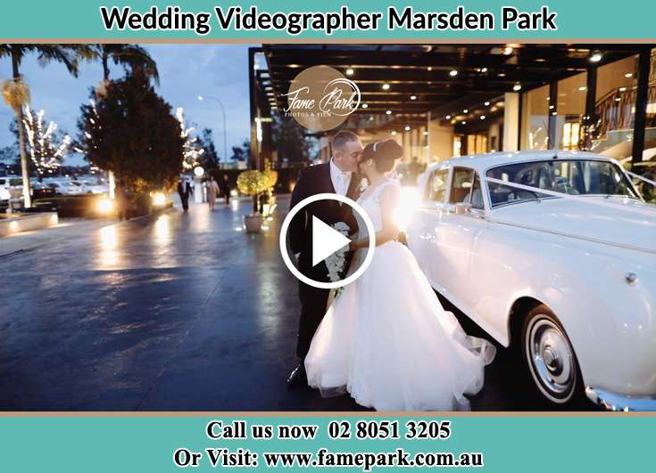 Bride and Groom kissed beside their car Marsden Park NSW 2765
