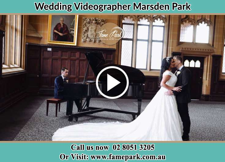 Bride and Groom kissed besides their wedding pianist Marsden Park NSW 2765
