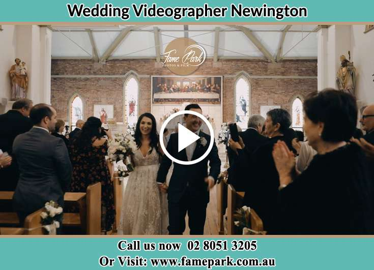 The newly weds walking through the well wishers Newington NSW 2127