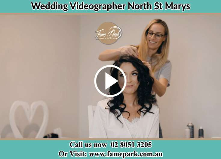 Bride getting her hair fixed North St Marys NSW 2760