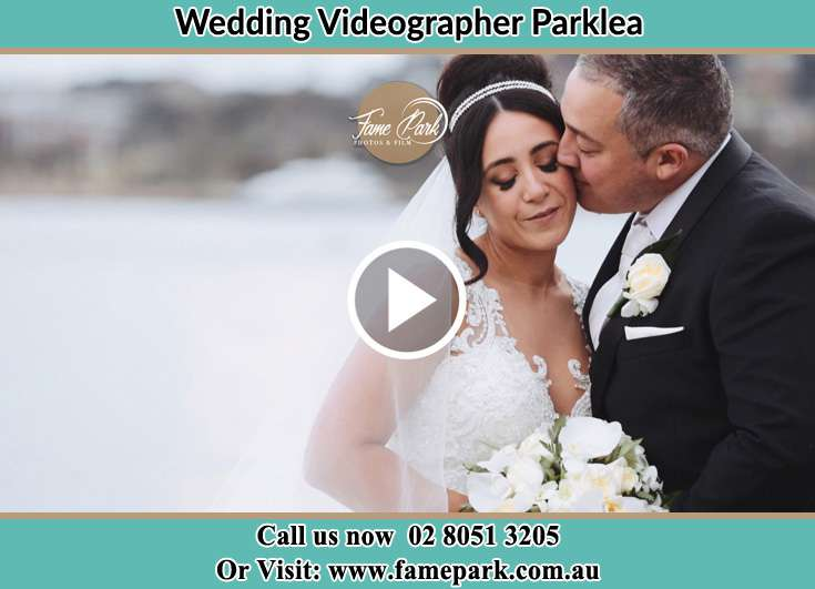 Bride and Groom kissed at the shore Parklea NSW 2768