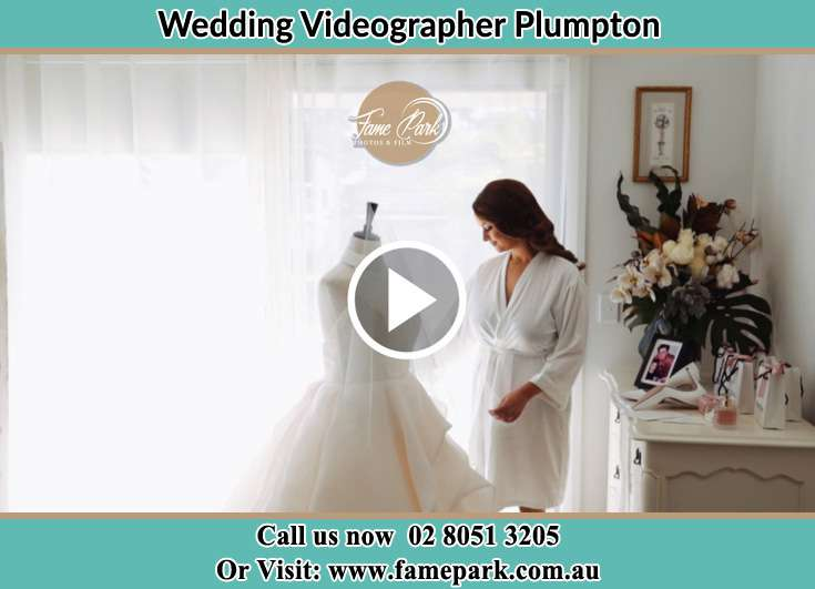 Bride looking at her wedding gown Plumpton NSW 2761
