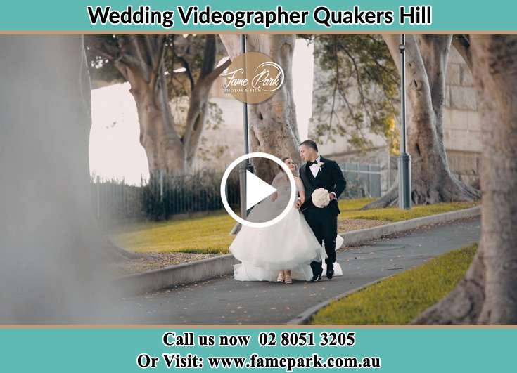 Bride and Groom looking at each other while walking in the park Quakers Hill NSW 2763