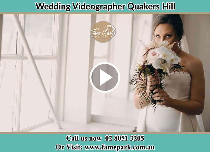 Bride smelling a bouquet of flowers Quakers Hill NSW 2763
