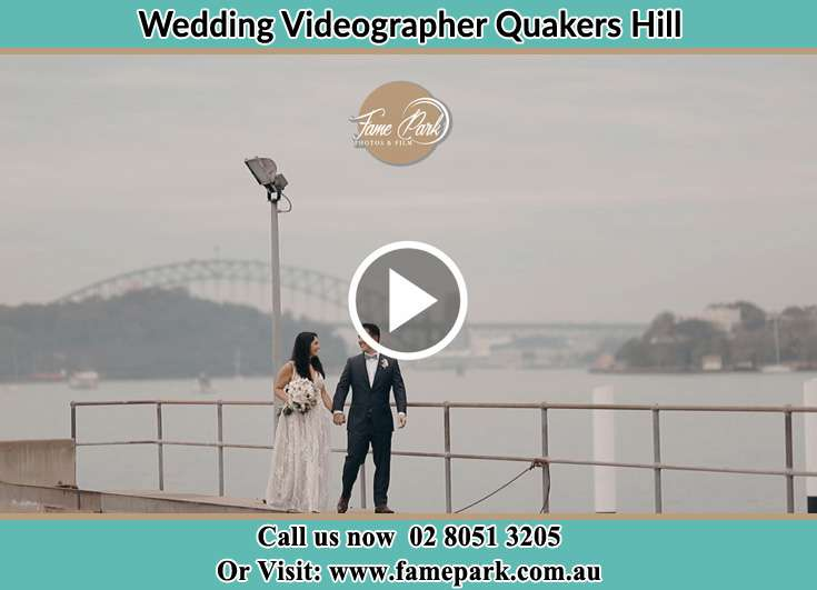 Bride and Groom looking at each other while walking near the shore Quakers Hill NSW 2763