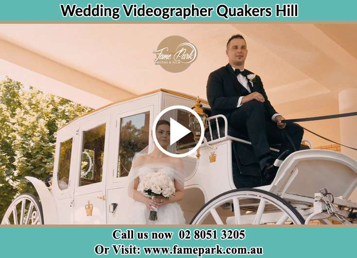 Bride and Groom at the carriage Quakers Hill NSW 2763