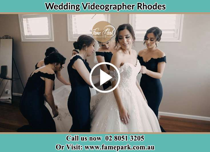 The girls spread out the wedding gown wore by the Bride Rhodes NSW 2138
