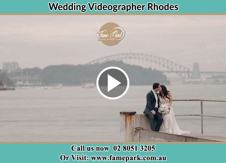 The new couple kissing at the bay Rhodes NSW 2138