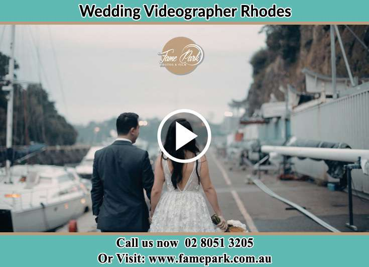 The new couple walking at the bay Rhodes NSW 2138
