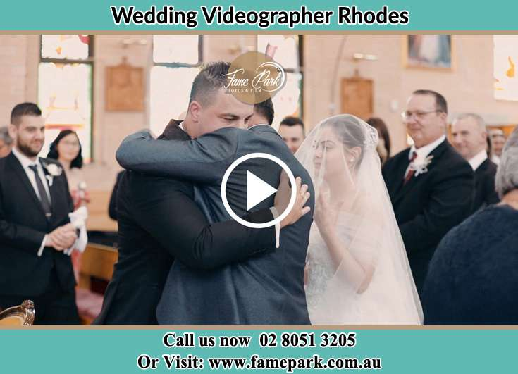The Groom hug the father of the Bride Rhodes NSW 2138