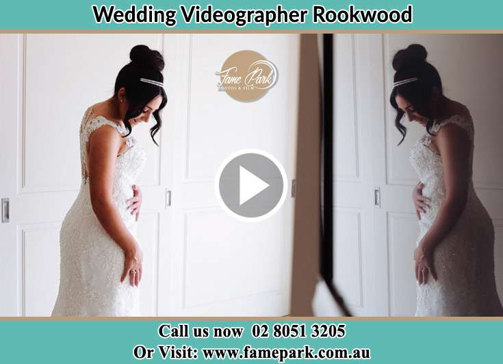 Bride looking at the mirror Rookwood NSW 2141
