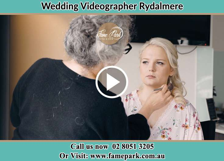 The Bride having a make-up with the help of the makeup artist Rydalmere NSW 2116