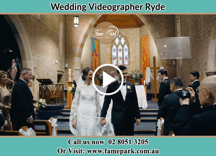 The newly weds walking through the well wishers Ryde NSW 2112