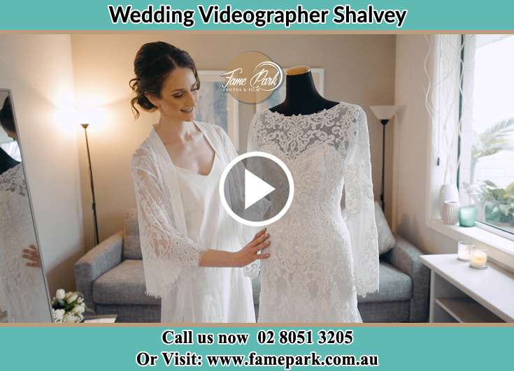 Bride looking at her wedding gown Shalvey NSW 2770
