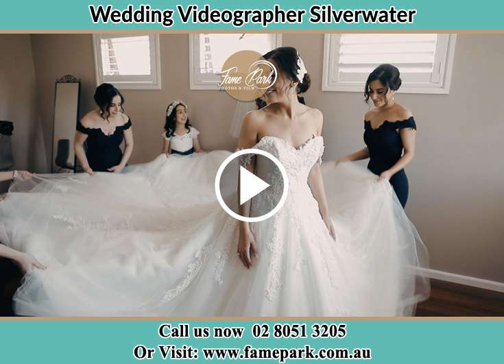 Bride and her secondary sponsors fixing her gown Silverwater NSW 2128