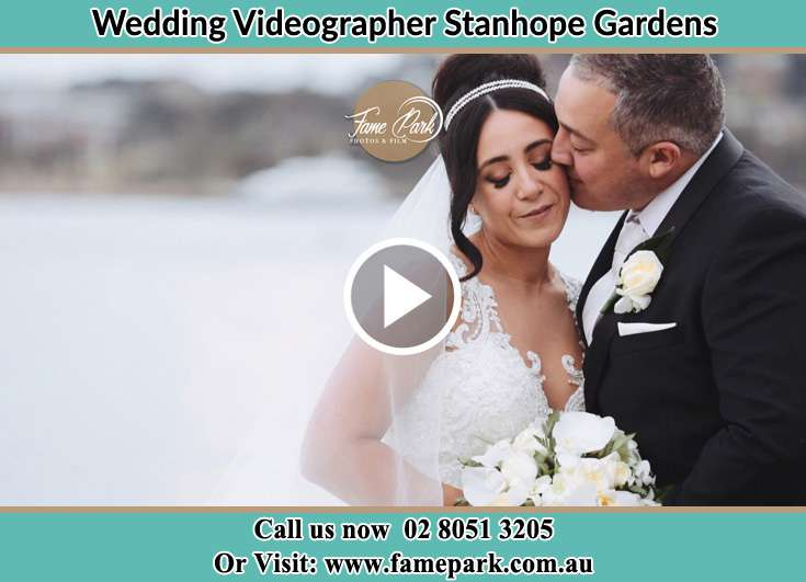 Bride and Groom kissed at the shore Stanhope Gardens NSW 2768