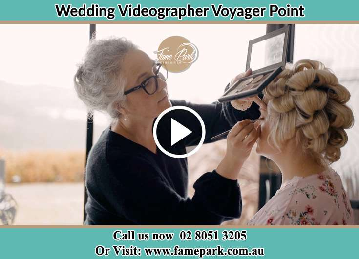 A woman applying makeup to the Bride Voyager Point NSW 2172