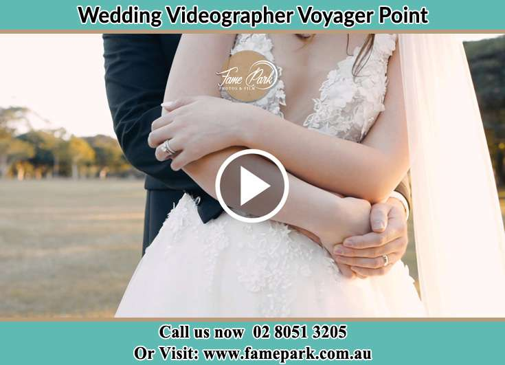 The Groom embracing the Bride Voyager Point NSW 2172