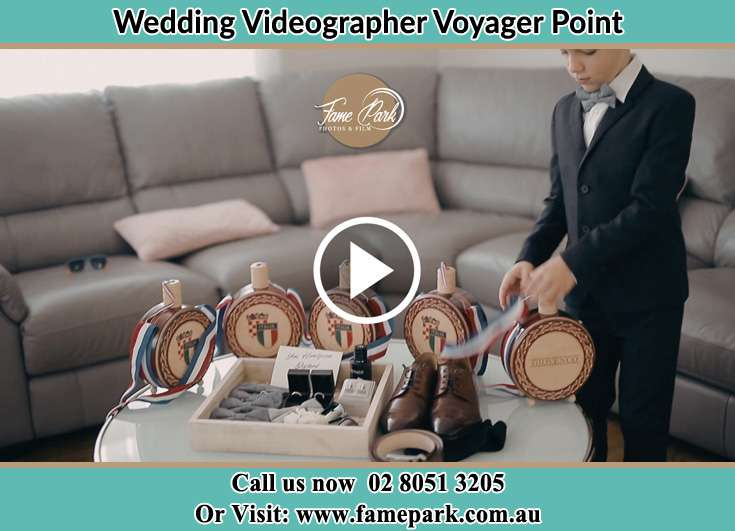 The Groom preparing the things to use for the wedding Voyager Point NSW 2172
